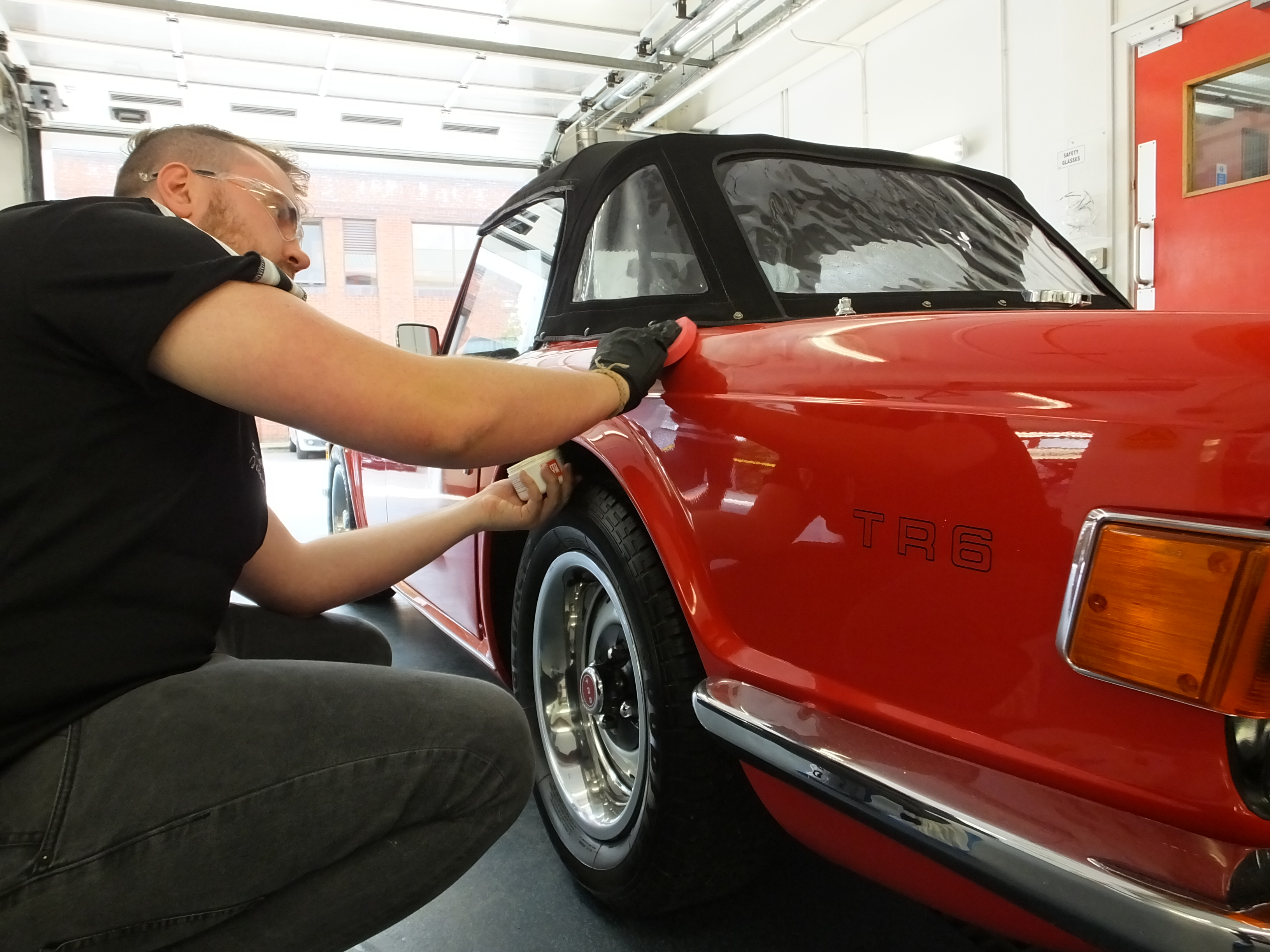 Autoglym high Definition Wax being applied to Triumph TR6